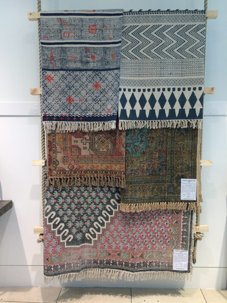FCUK rugs in muted shades