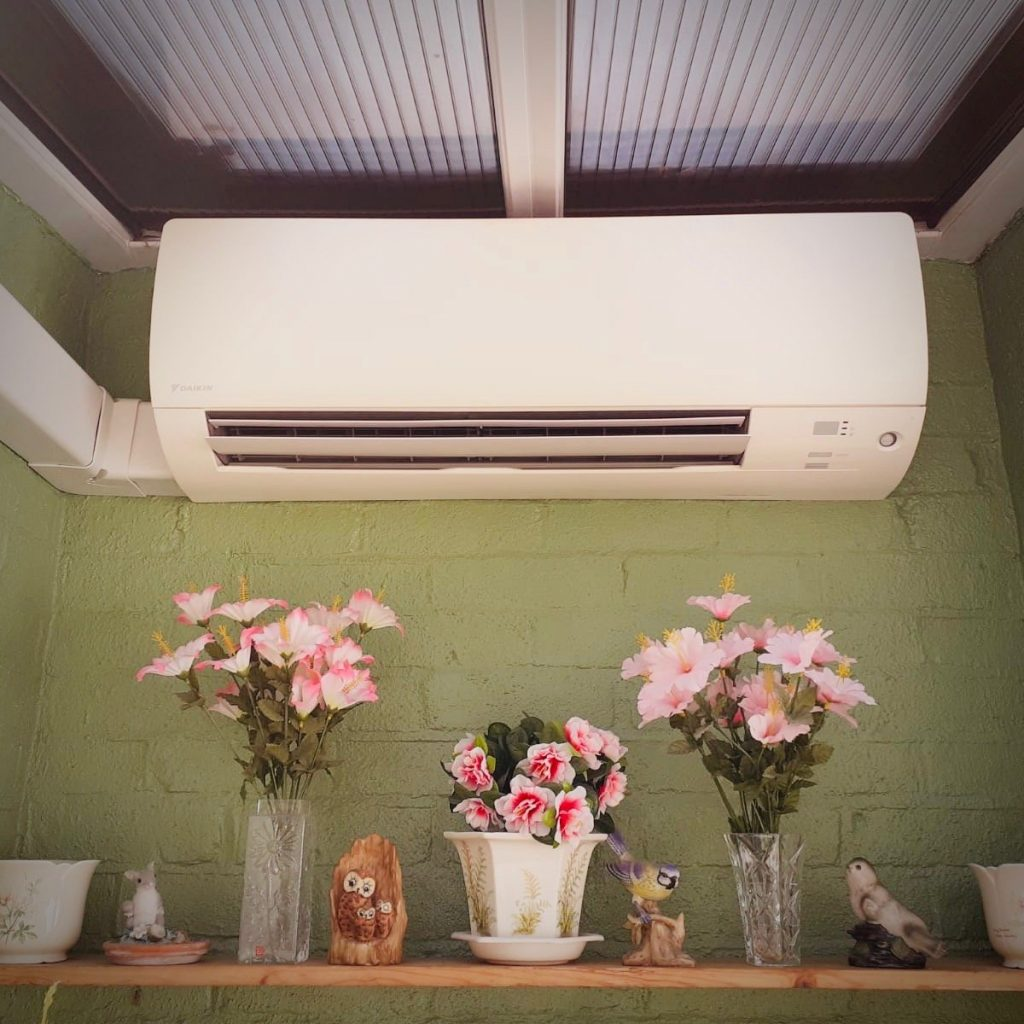 Wall mounted a/c unit in conservatory