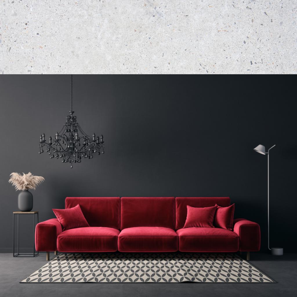Red velvet sofa set against a black background