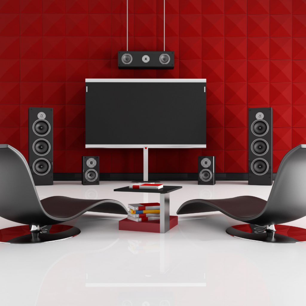 Home cinema with grey chairs set against a red wall
