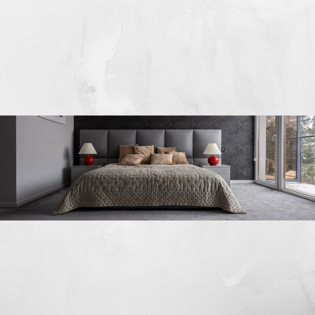 Grey bed with red accessories