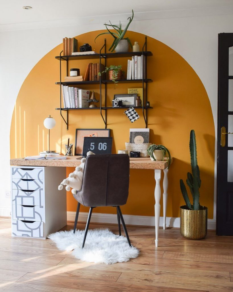 Room zoning using painted arch on wall